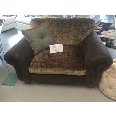 Richmond Standard back snuggler chair in Jin black leather and Modena khaki velvet