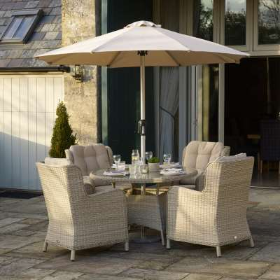 2021 Bramblecrest Chedworth Round Table Dining Set with 4 High-Back Armchairs & Parasol - Sandstone